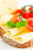 Cheese sandwich with fresh tomato and basil close up Stock Photo