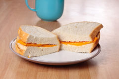 Cheese sandwich and mug Royalty Free Stock Images