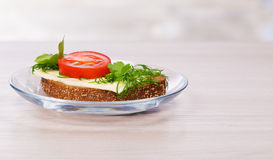 Cheese sandwich with parsley and dill tomato. Royalty Free Stock Photography