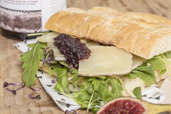 Cheese sandwich served with salad Stock Images