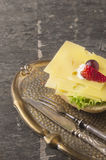 Cheese sandwich in vitage tray with fork and knife Stock Photo