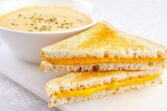Cheese sandwiches with soup. Two cheese sandwiches with a bowl of soup Stock Image