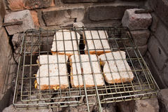 Cheese sandwiches toasted over coals Stock Image