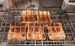 Cheese sandwiches toasted over coals Royalty Free Stock Images