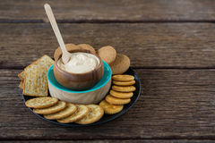 Cheese sauce with biscuits in black plate Royalty Free Stock Image