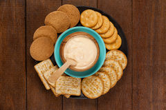 Cheese sauce with crispy biscuits in plate Stock Photo