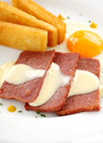 Cheese Sauce And Spam. Fried spam with a delicious cheese sauce and toast fingers Royalty Free Stock Images