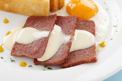 Cheese Sauce And Spam. Fried spam with a delicious cheese sauce and toast fingers Royalty Free Stock Image