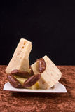 Cheese & Sausage. Cubes of cheese and sausage served in a white plate Stock Images