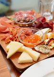 Cheese and sausage platter Stock Photos