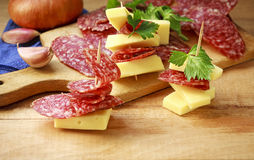 Cheese and sausage slices for an appetizer Stock Photos