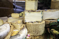 Cheese and sausages exposure in a market stall. Color image Royalty Free Stock Photography