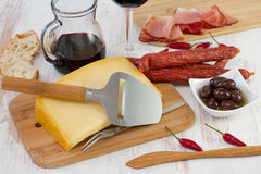 Cheese with sausages, olives Royalty Free Stock Images
