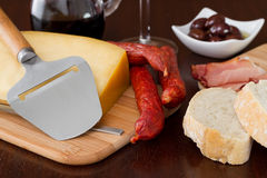 Cheese with sausages, olives Stock Images