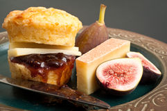 Cheese scone. Savoury cheese scone with fig jam and compte cheese Royalty Free Stock Photos