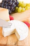 A cheese selection with grapes. And strawberries Royalty Free Stock Image