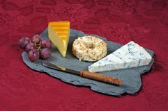 Cheese selection on Welsh slate. Royalty Free Stock Photography