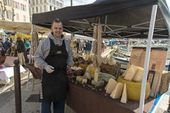 Cheese seller La Ciotat Sunday market royalty free stock photo