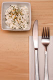 Cheese sesame salad. With knife and fork Stock Photography