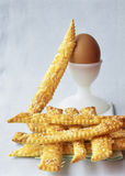 Cheese and sesame seed flaky pastry sticks Stock Image