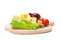 Cheese and  set of vegetables isolated on white background Royalty Free Stock Photos
