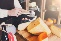 Cheese shop assistant swipe credit card. At counter, paying for order in grocery Royalty Free Stock Image