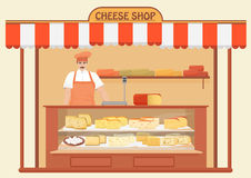 Cheese Shop. Man Seller. Store shelves with different kind of Cheese set. Parmesan mozarella swiss emmentaler cheddar Stock Photo