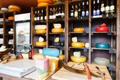 Cheese shop shelves, large assortment Stock Photos