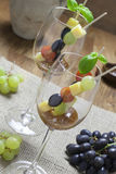 Cheese skewer in wine glass Stock Images