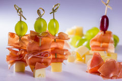 Cheese skewers. With grapes and ham Stock Photo