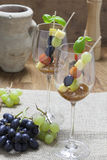 Cheese skewers and grapes in a Wine glass Royalty Free Stock Image