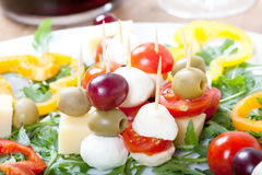 Cheese skewers with mozzarella, cherry tomatoes, olives and sweet pepper Stock Image