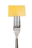 Cheese slice on fork Royalty Free Stock Photos