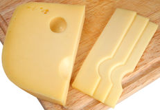 Cheese sliced. On a chopping board Royalty Free Stock Photos
