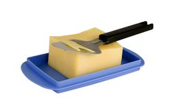 Cheese slicer. And some cheese on a white background stock photos