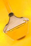 Cheese Slicer. Wire Cheese Slicer against a yellow background Stock Photos