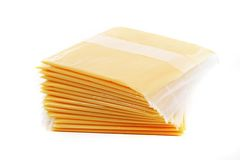 Cheese slices. Slices of cheese individually wrapped, isolated on white Stock Images