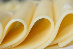 Cheese slices. Couple of very thick gouda cheese slices Stock Photos