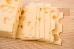 Cheese slices on cutting board Royalty Free Stock Photography