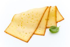 Cheese slices isolated on the white background. Royalty Free Stock Photo