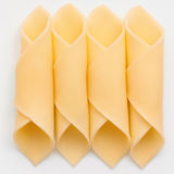 Cheese slices neatly rolled Stock Images