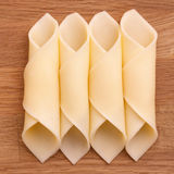 Cheese slices neatly rolled Royalty Free Stock Image