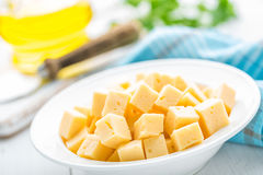 Cheese slices on plate. White background Stock Photography