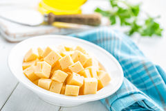 Cheese slices on plate Royalty Free Stock Photos