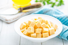 Cheese slices on plate Stock Photo