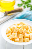 Cheese slices on plate Stock Image