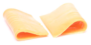 Cheese slices on white. Slices of cheese isolated on white background Stock Photography