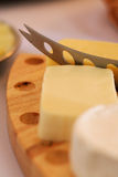 Cheese slicing Stock Photo