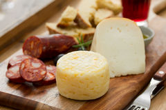 Cheese with smoked sausage, bread and wine Stock Photography