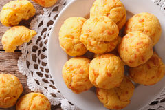 Cheese snack buns close-up on a plate. Horizontal top view royalty free stock images